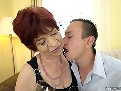 Blonde granny Amelie sucks off her young master