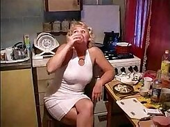 Blonde mom with skinny body Lilith masturbates in the kitchen