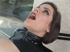 Brigette in latex mask seduces a freak in a bar