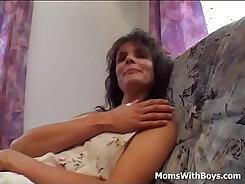 Busty cougar caught masturbating in the morning