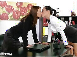 porn star with dark hair is pushing her mouth and tongue inside of her female friend